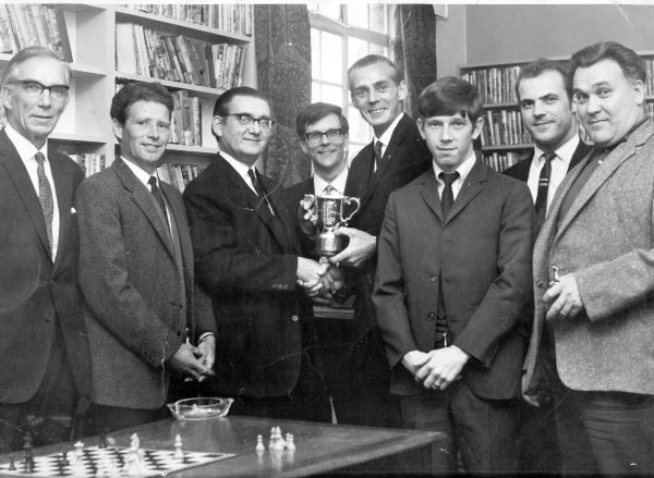 Winwick chess team presentation, 1970: Ted Fox, Brian Clare, Brian Ward, Roger Bruton, Joe Jolley, Terry Allen, David McKendrick, Jack Minshull. Submitted by Brian Clare.