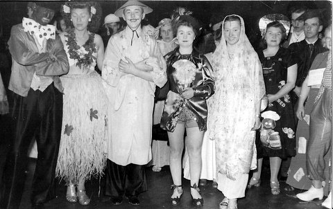 Fancy Dress Ball, front row only:-  Jeff Evans, ?, Brian Stapleton, Beryl Evans, ?, ?. Submitted by Brian Stapleton